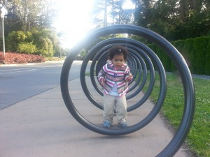 Kids playing around bike racks in front of Tea Garden.